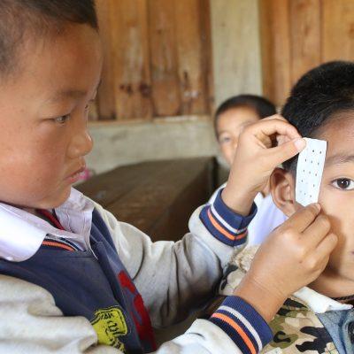 Children receiving first aid training, Laos